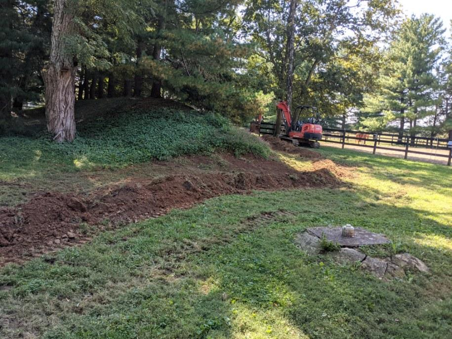 Dug up water line with a backhoe in the background